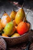 Gac fruits in a basket Stock Photo