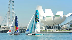 GAC Pindar racing Red Bull Sailing Team at Extreme Sailing Series Singapore 2013 Stock Photography