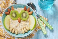 Gachas de avena del desayuno de los niños Imagen de archivo