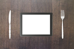 Gadget concept with blank digital tablet screen with fork and kn Stock Photos