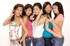 Gadget Girls #2. Five young asian women with phones and mp3 players Stock Photography