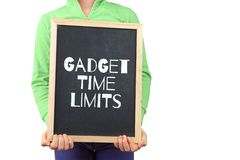 Gadget time limits for children subject depicted. Gadget time limits for children subject depicted with child holding blackboard with text and copy space royalty free stock photos