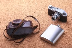 Gadgets and accessories for men on light wooden background. Fashionable men s lighter, Stainless hip flask and retro. Camera Royalty Free Stock Photo