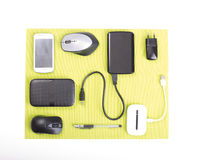Gadgets on the desk. Top view of gadgets on green pad on white desk Stock Photo