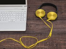 Gadgets for every day ready for their work. Laptop, headphones, music player, smartphone - gadgets for every day Royalty Free Stock Photo