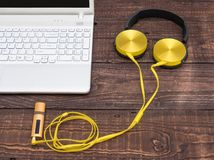 Gadgets for every day ready for their work. Laptop, headphones, music player, smartphone - gadgets for every day Stock Photography