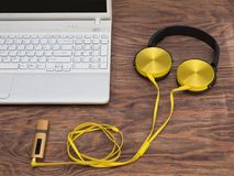 Gadgets for every day ready for their work. Laptop, headphones, music player, smartphone - gadgets for every day Royalty Free Stock Photos