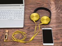 Gadgets for every day ready for their work. Laptop, headphones, music player, smartphone - gadgets for every day Royalty Free Stock Photography