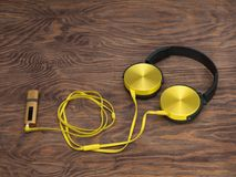 Gadgets for every day ready for their work. Music player and headphones - gadgets for every day Stock Photography