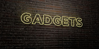 GADGETS -Realistic Neon Sign on Brick Wall background - 3D rendered royalty free stock image Stock Image