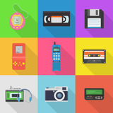 Gadgets 90`s vector icon set. Popular in the 90`s gadgets game console, pager, audio cassette, player, floppy disk, vhs cassette, etc. Old hipster tech gadgets Stock Illustration