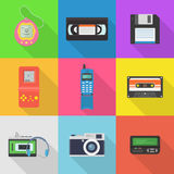 Gadgets 90`s vector icon set. Popular in the 90`s gadgets game console, pager, audio cassette, player, floppy disk, vhs cassette, etc. Old hipster tech gadgets Royalty Free Illustration