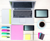 Gadgets on wooden background.Workplace upper view. Royalty Free Stock Photos