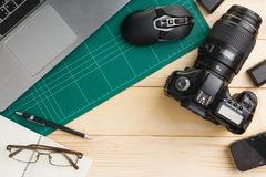 Gadgets on wooden desk. Top view of office stuff and gadgets on wooden desk with graphic designer equipment. flat lay style Royalty Free Stock Photo