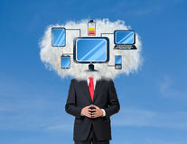Gadgets. Young businessman with white cloud on his head connected to gadgets stock photos