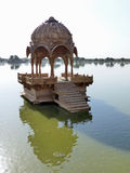 Gadsisar Tank, Jaisalmer. A man-made lake in Jaisalmer, once the setting for cremations and still surrounded by ghats and small temples Stock Photos