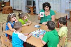 The educator deals with children. Gadjievo, Russia - January 13, 2011:  The educator deals with children Stock Photo