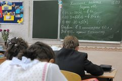 Children in the class solve a mathematical problem Royalty Free Stock Images