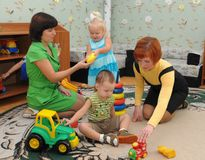Kindergarten teachers play with children Royalty Free Stock Photography