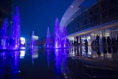Gae Aulenti square night scene. Violet colored water jets in the new Gae Aulenti square in Milan stock image
