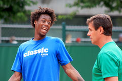 Gael Monfils at Roland Garros 2011. Gael Monfils training at Roland Garros 2011, just before the game versus David Ferrer. Beside him, Patrick Chamagne, which Stock Image