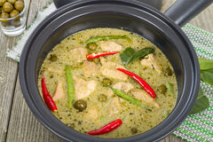 Gaeng Khiao Wan Gai. Thai green chicken curry with baby aubergines and snake beans Royalty Free Stock Images