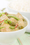 Gaeng Khiao Wan Gai. Thai green chicken curry with baby aubergines and snake beans served with steamed jasmine rice Royalty Free Stock Images