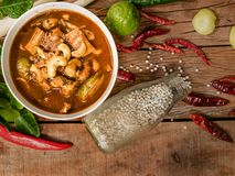 Gaeng Tai Pla, fish organs sour soup, traditional southern Thai food. Spicy curry made from fermented fish organ and mix with assortment of vegetables always stock image