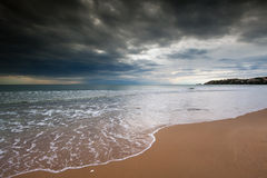 Gaeta Serapo Beach. The italian beach of Serapo in Gaeta under a stormy and cloudy sky and wavy sea Stock Photos