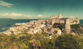 Gaeta view with ancient castle on coastal rock. Landscape of old town Gaeta with ancient castle on coastal rock, Italy. Vintage warm tonal correction photo Stock Photography
