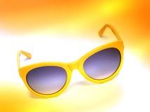 Gafas de sol amarillas foto de archivo