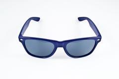 Gafas de sol plásticas azules Fotografía de archivo