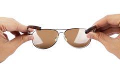 Gafas de sol que desgastan Fotos de archivo