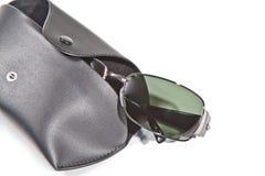 Gafas de sol y caso Fotografía de archivo libre de regalías