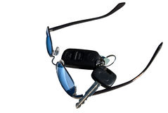 Gafas de sol y claves del coche Foto de archivo libre de regalías