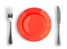 gaffel isolerad röd övre sikt för knivplatta Royaltyfri Foto