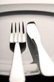 Gaffel, kniv och platta Arkivbild