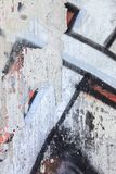 Gaffiti closeup in a damaged concrete wall Stock Photo