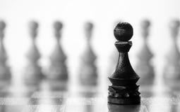 Gage de pièce d'échecs à bord Photos stock