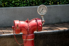 Gage. Red pipe for firefighter with Gage stock photography