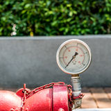 Gage. Red pipe for firefighter with Gage royalty free stock images