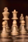 Gages d'échecs dans la rangée Image stock