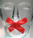 Gagged. Glass head with tape depicting silence or restricted Royalty Free Stock Photography