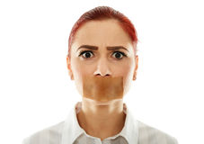 Gagged businesswoman isolated on white. Muted businesswoman with adhesive tape over her mouth, closeup royalty free stock photography