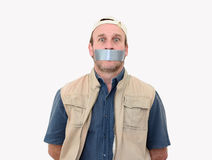 Gagged. A man gagged with tape over his mouth Royalty Free Stock Image