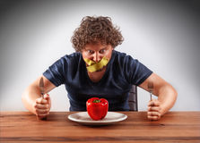 Gagged man wants to eat Royalty Free Stock Photography