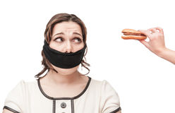 Gagged plus size woman seduced with hamburger Stock Photography