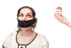 Gagged plus size woman seduced with pastry Stock Photography