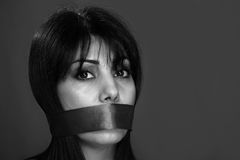 Gagged woman. Not allowed to speak, in monochrome royalty free stock photography