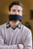 Gagged young man cannot speak Royalty Free Stock Image